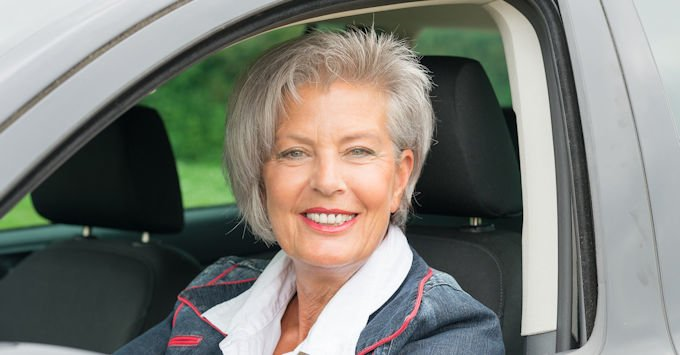 Mature women in her car